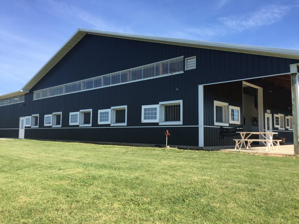 swing open stall windows allow air flow through the barn